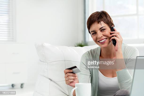 Woman holding cradit card and using laptop
