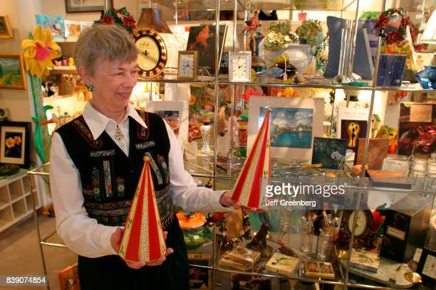 A woman holding crafts at Artful Giving Show in the Peninsula Fine Arts Center