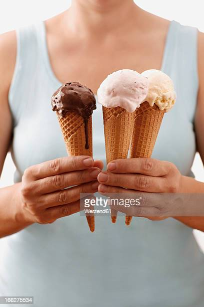Woman holding different ice cream cones