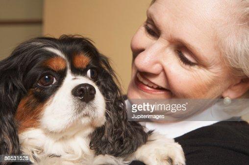 Woman holding dog : Stock Photo