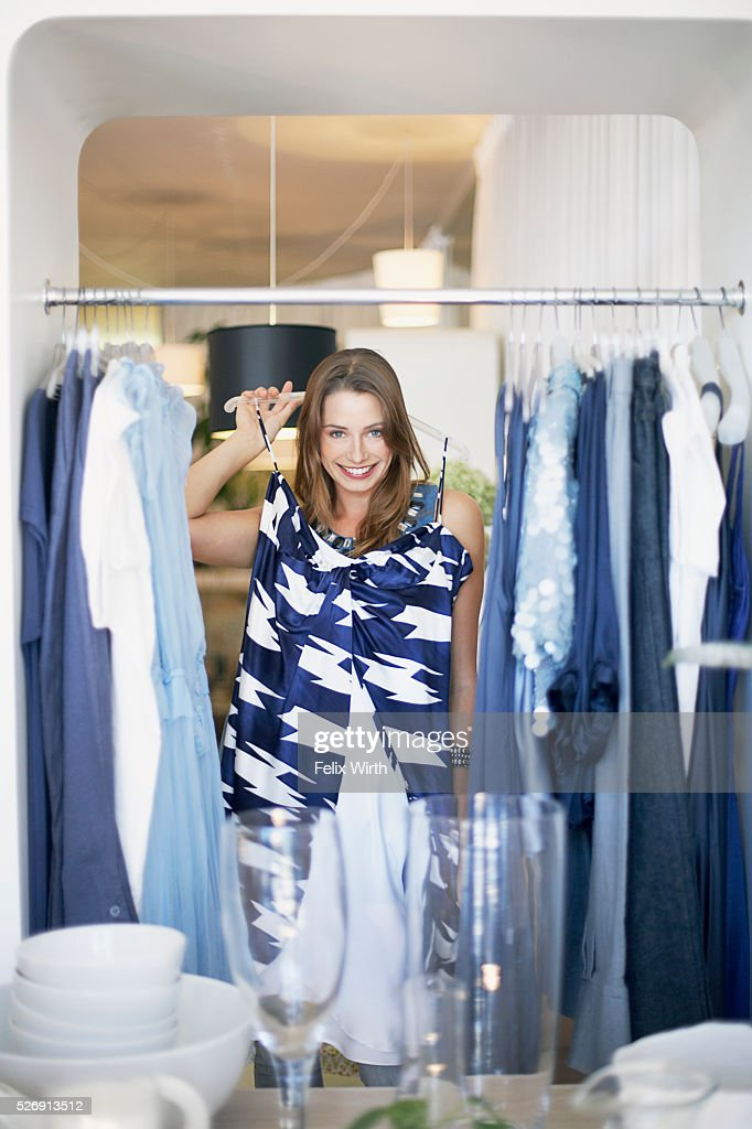 Woman holding dress : Stock Photo