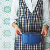 Woman holding dutch oven