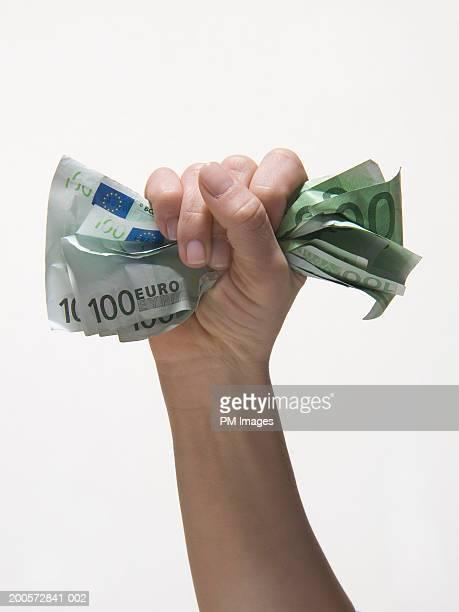 Woman holding Euro banknotes, close-up