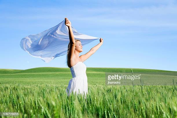Woman Holding Fabric in Wind