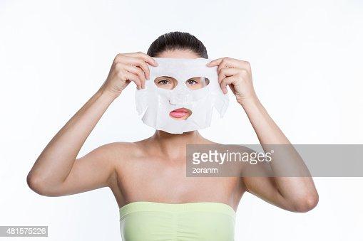 Woman holding facial mask