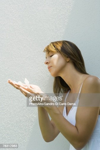 Woman holding fake butterflies on hand : Stock Photo