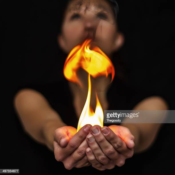 Woman holding fire in her hand
