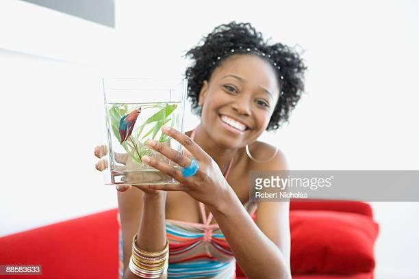 Woman holding fishbowl