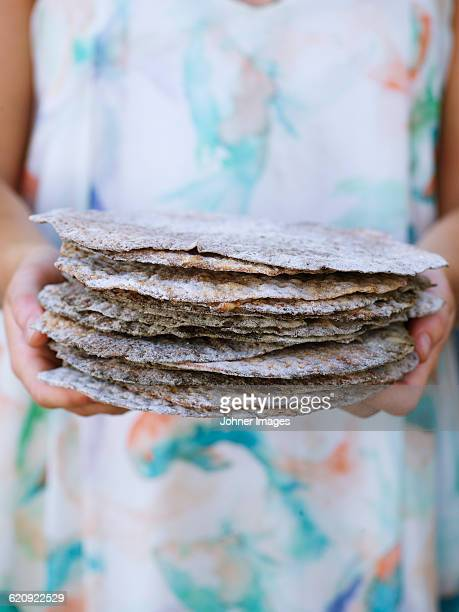 Woman holding flat breads