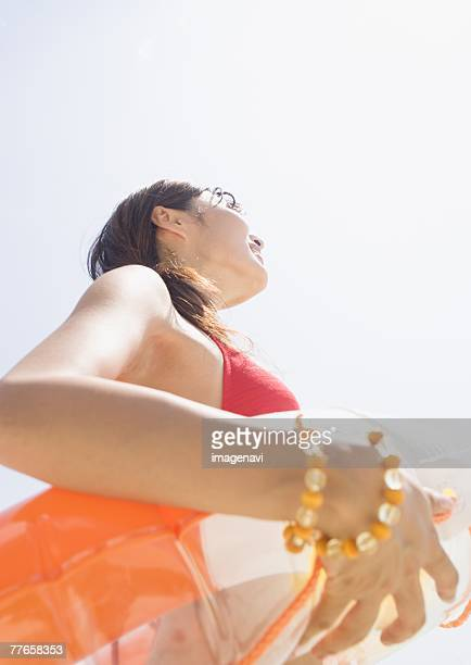 Woman holding float