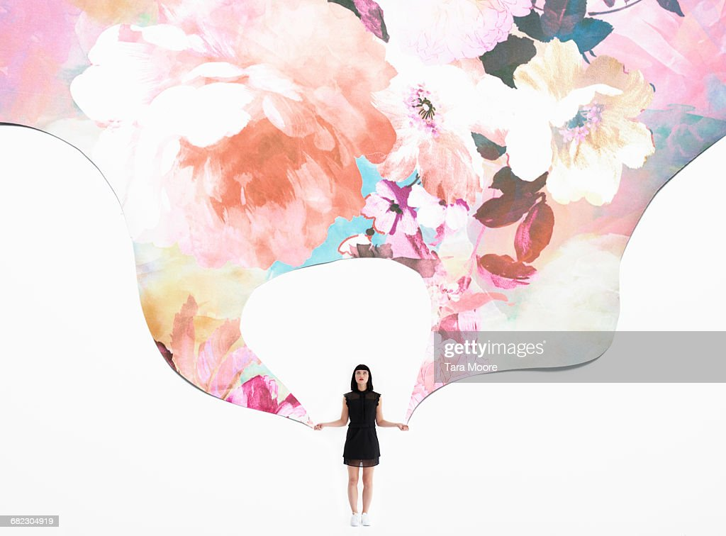 woman holding flowered wallpaper : Stock Photo