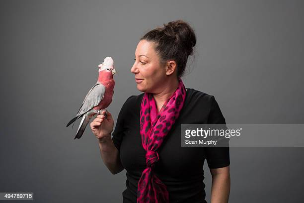 Woman holding Galah Cockatoo