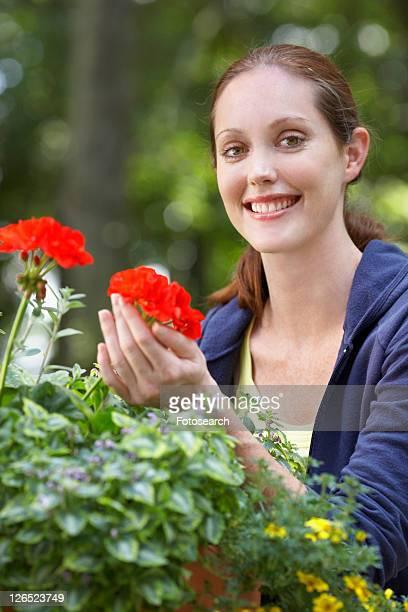 Woman holding Geranium flower