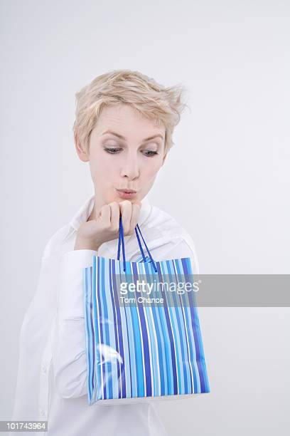 Woman holding gift bag, portrait
