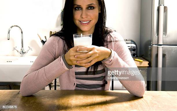 Woman holding glass of milk.