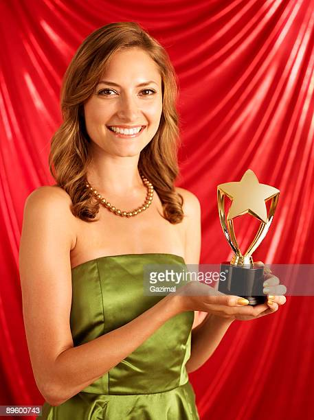 Woman holding golden trophy