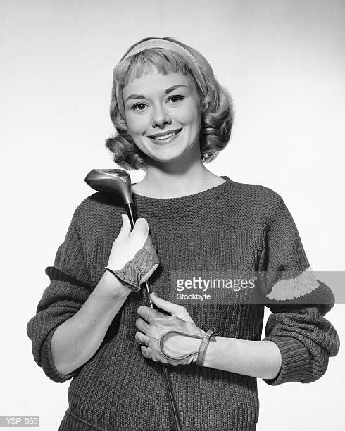 Donna con golf club