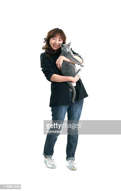 woman holding gray cat