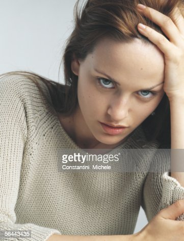 Woman holding head, portrait