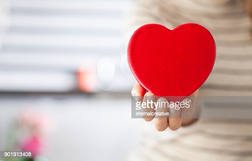 Woman holding heart : Stock Photo