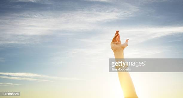 Woman holding her arm in the air