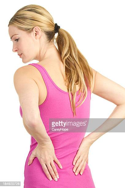 Woman holding her back looking like she is in pain