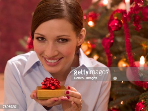 Woman holding her Christmas gift. : Stock Photo