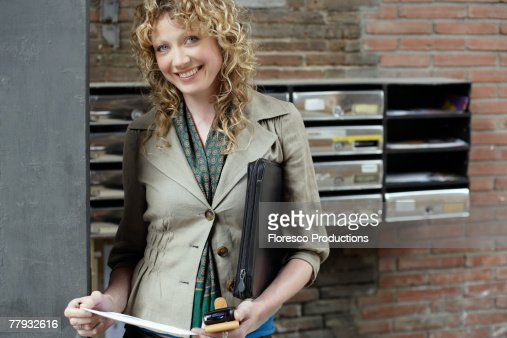 Woman holding her mobile phone : Stock Photo