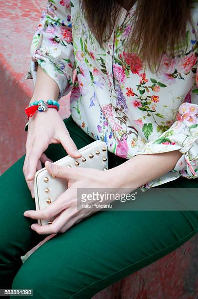 Woman holding her wallet