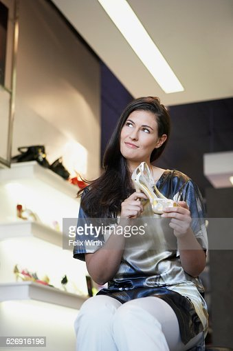 Woman holding high heel shoe : Stock Photo