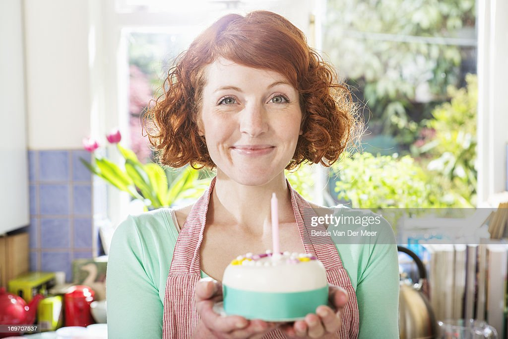 Woman holding homemade birthday cake. : Stock Photo