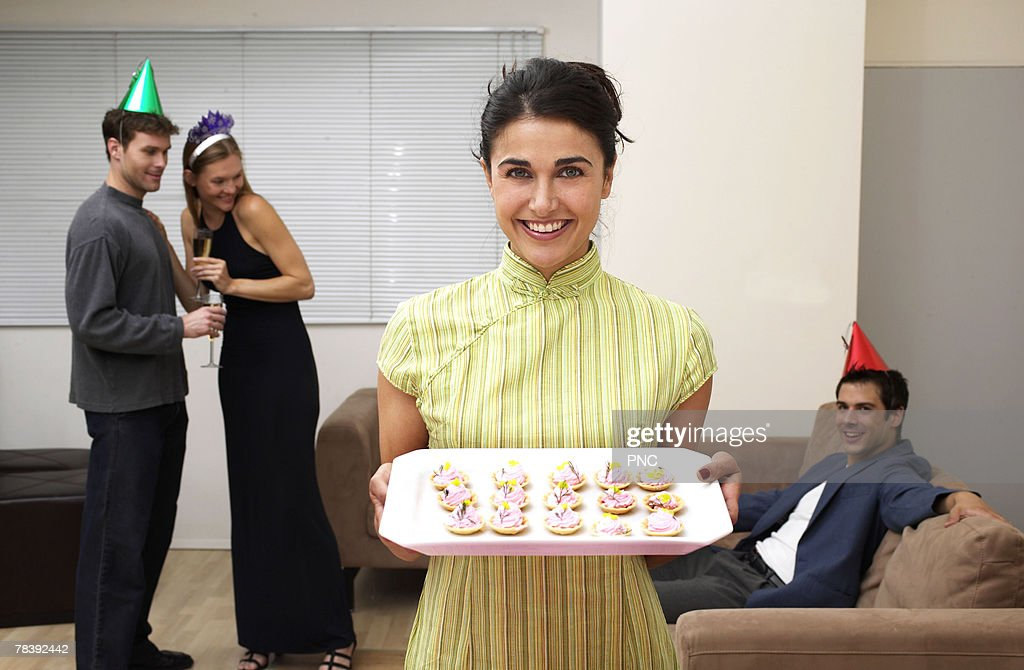 Woman holding hors d'oeuvre tray