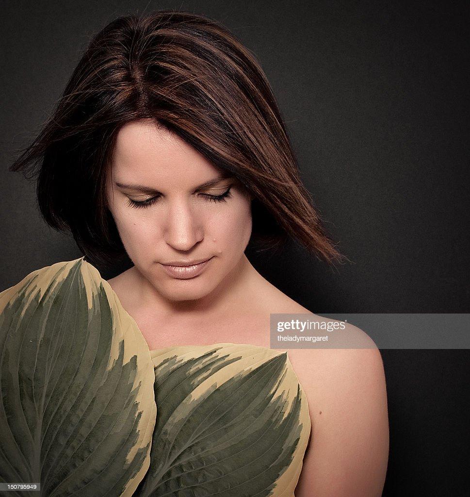 Woman holding hosta leaves : Stock Photo