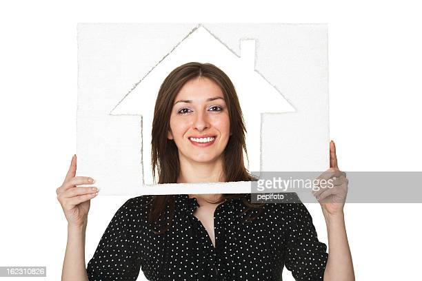 woman holding house sign