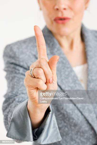 Woman holding index finger in the air