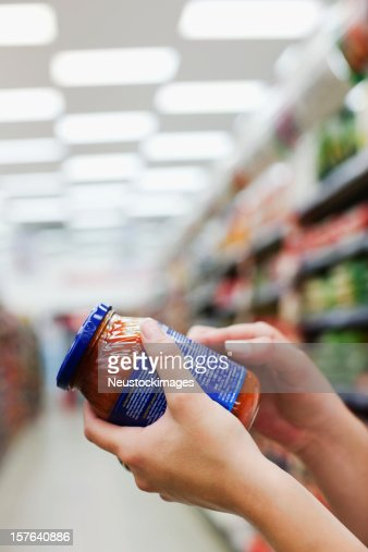 Woman Holding Jar of Food