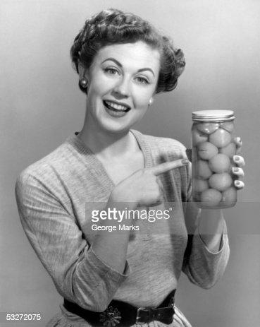 Woman holding jar of fruit : Stock Photo