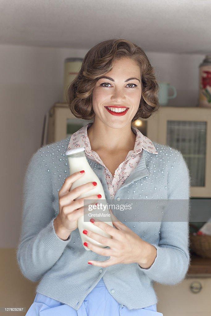 Woman holding jug of milk