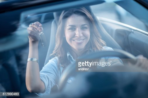 Woman holding keys of her car