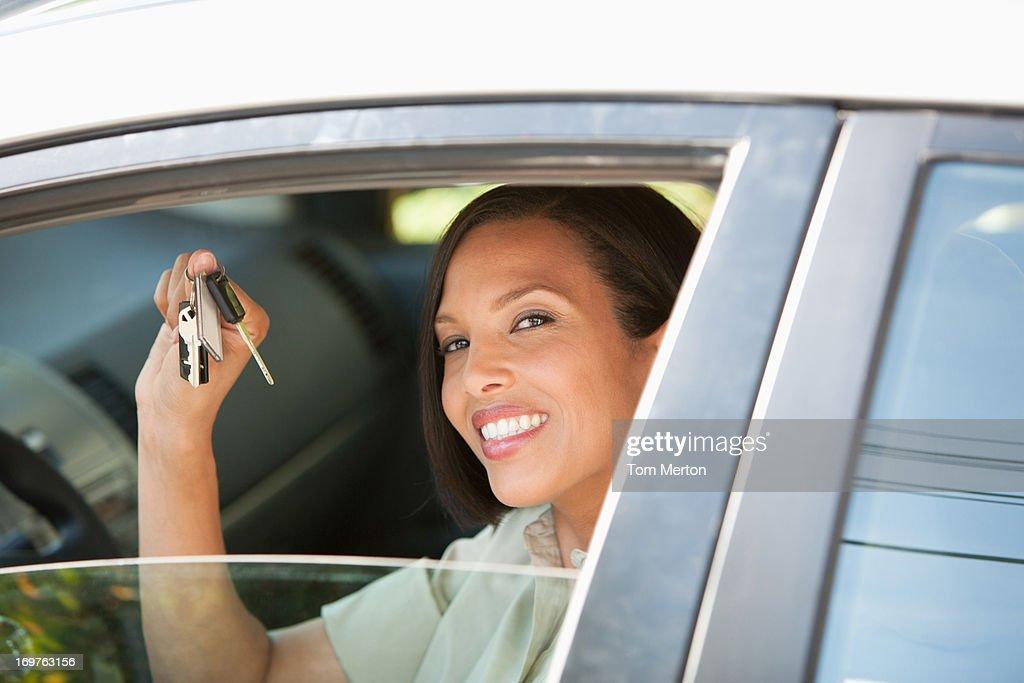 Woman holding keys to new car : Stock Photo