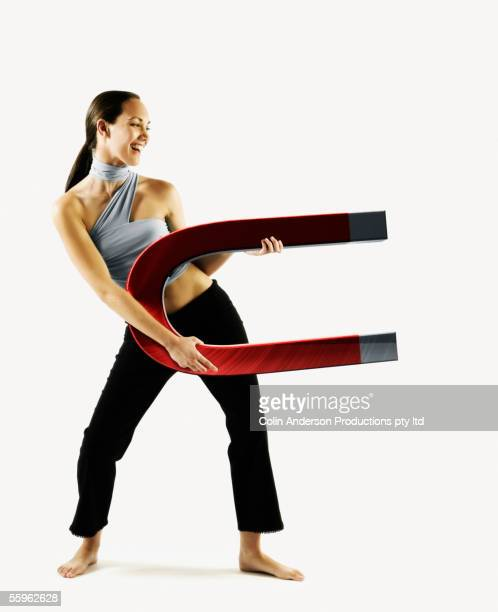 Woman holding large magnet