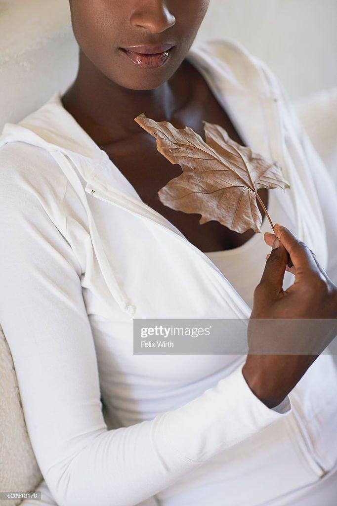 Woman holding leaf : Bildbanksbilder
