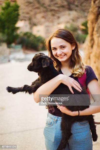 Woman holding little goat