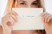 Woman holding love note