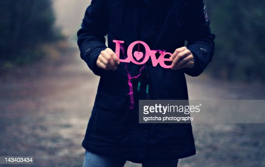Woman holding love word : Stock Photo