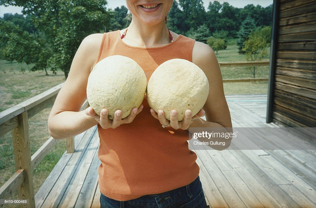 naked woman holding melons