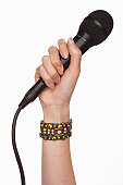 Woman holding microphone (focus on microphone)