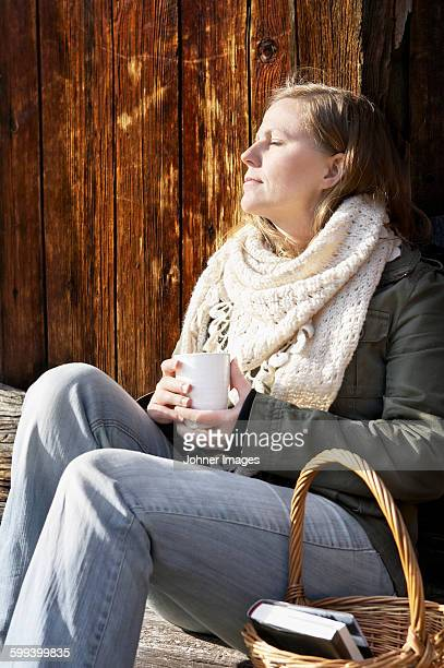 Woman holding mug and relaxing