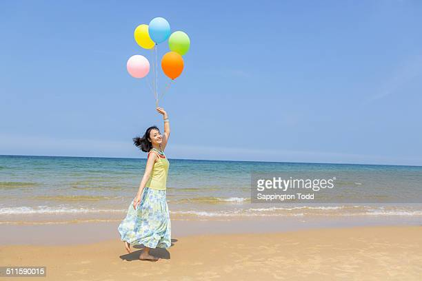 Woman Holding Multicoloured Balloons