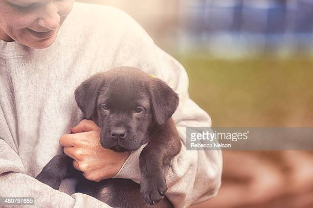 woman holding new puppy